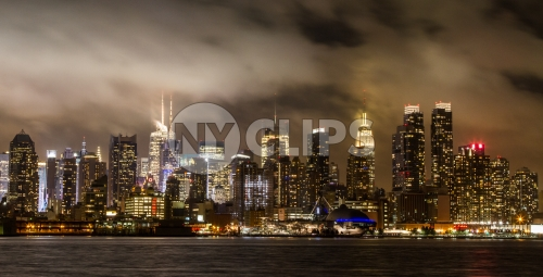 Manhattan skyline on cloudy muggy night with Empire State Building