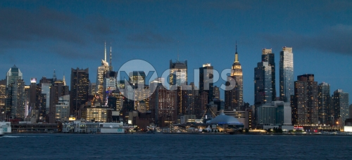 Manhattan skyline in early evening on beautiful night with Empire State Building lights