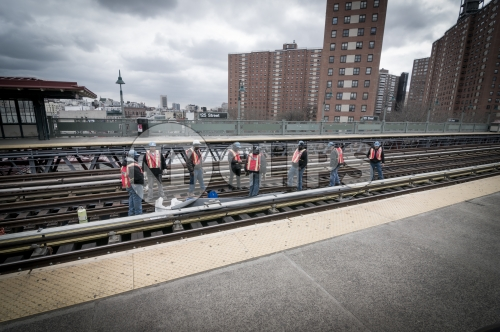 MTA workers on elevated subway station track on 125th Street in Harlem, Uptown Manhattan
