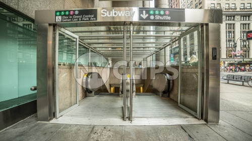 subway entrance on 42nd street and Lexington Ave on East Side of Manhattan - down escalators to train station in Midtown Manhattan
