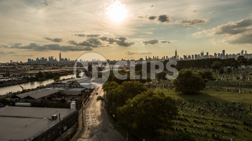 Manhattan skyline with Calvary Cemetery in Queens at sunset in early evening late afternoon in NYC