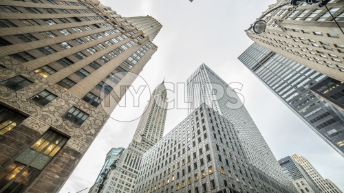 upward angle of Midtown Manhattan skyscrapers including famous Chrysler Building