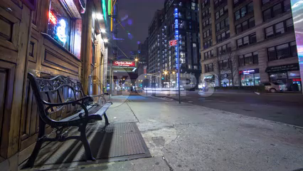 nightlife street bench outside pub in Manhattan - 4K time-lapse with streaks of light from cars