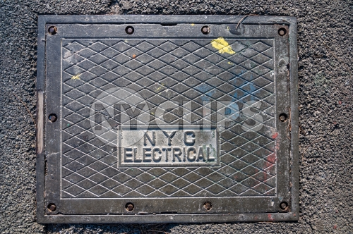 NYC electrical square cover on concrete