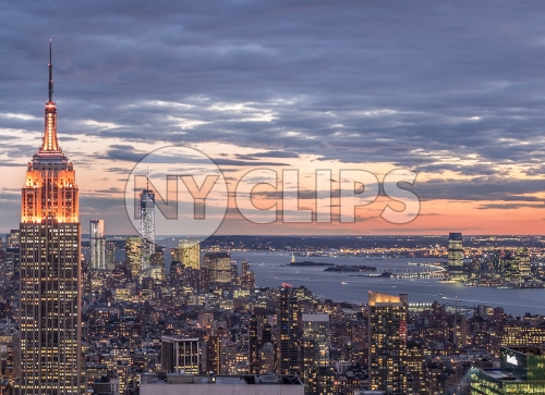 famous landmarks - Empire State Building and Freedom Tower in breathtaking Manhattan cityscape from high view at sunset in early evening NYC