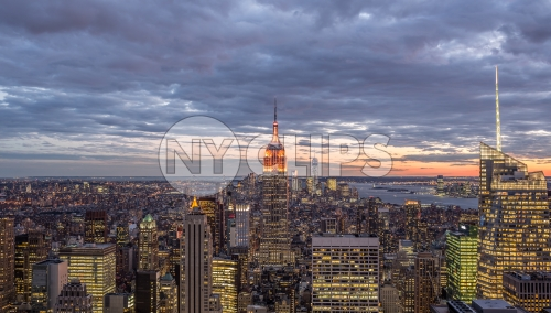 Empire State Building at sunset in early evening - Manhattan cityscape with skyscrapers from high view