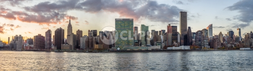 Manhattan skyline at sunset from across East River - super wide