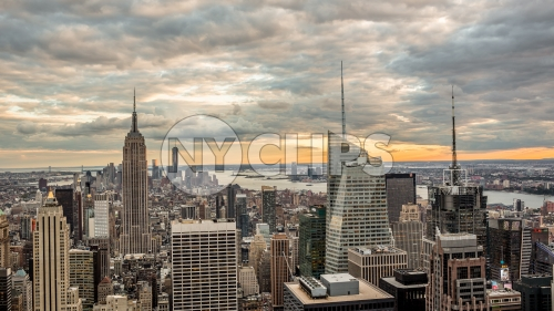 Empire State Building and Times Square skyscrapers in Manhattan cityscape at sunset from high view