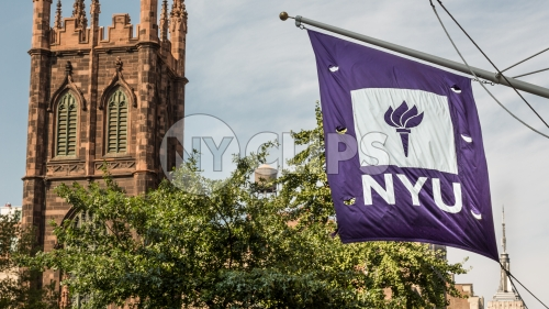 NYU flag and First Presbyterian Church on Lower 5th Ave in Manhattan on summer day