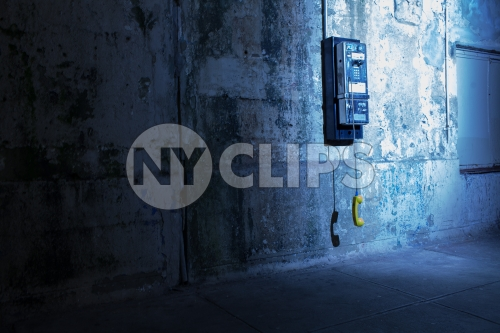 gritty dirty dangling public payphone in subway station in Brooklyn - off the hook