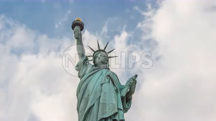 Statue of Liberty upward angle front medim shot - 4K timelapse in New York City