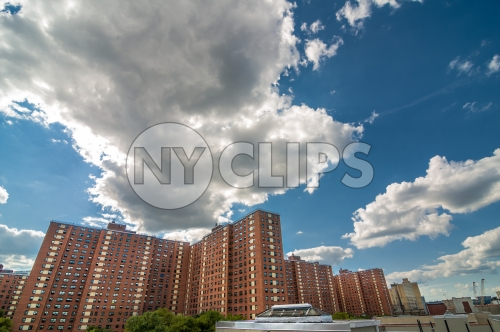 red brick buildings with blue sky and clouds on sunny summer day