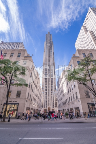 Rockefeller Center on sunny day with blue sky and clouds in Midtown Manhattan