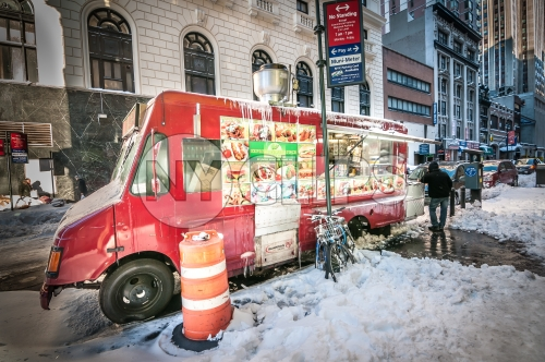 snack truck in Manhattan in winter - snow on ground in street