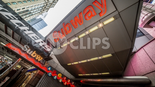 Times Square subway sign on 8th Ave in Manhattan - bright lights overwhelming train station