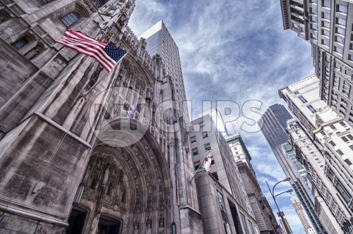 Saint Paul's Cathedral with American flag in Midtown Manhattan on sunny day in HDR