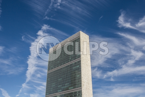 United Nations Building - view from side - isolated on blue sky with clouds on beautiful sunny summer day