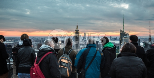 tourists appreciating view of Empire State Building in Manhattan NYC