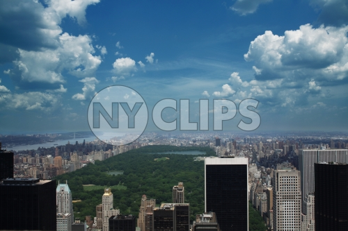 Central Park from high view with blue sky and clouds - skyscrapers and buildings