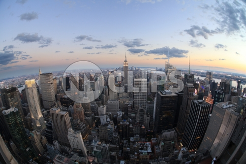 Manhattan cityscape from high aerial view - Empire State Building at sunset - beautiful evening lights in city