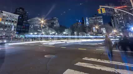 zooming out from Union Square at night in HDR - timelapse with streaks of light, motion blur cars sped up