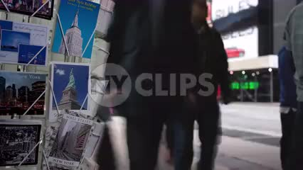 timelapse of postcards and people walking by in Midtown Manhattan winter