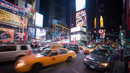 Times Square timelapse at night with bright Coca-Cola ad, billboards and signs - taxis speeding in traffic - 4K in NYC