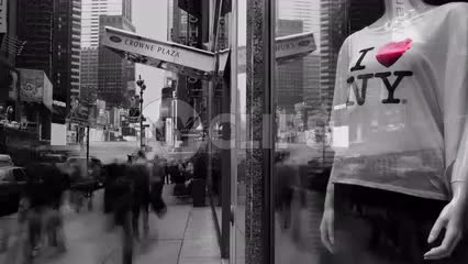black and white scene in Midtown Manhattan with I Love New York T-shirt in window