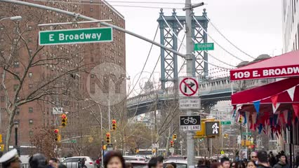 Manhattan Bridge view from East Broadway in Chinatown Little Italy in Downtown on cloudy fall day