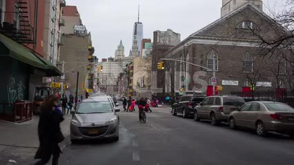 street in Chinatown in winter with Freedom Tower in background - Downtown Manhattan