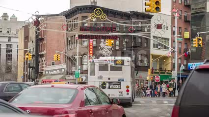 welcome to Chinatown sign on Chinese new year on busy intersection in winter