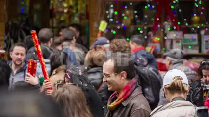 Chinese new year parade with people celebrating with confetti in Chinatown