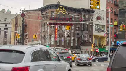 Chinatown welcome sign on busy intersection