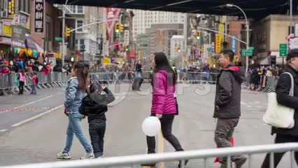 Asian-Americans crossing street in Chinatown on Chinese New Year