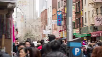 poppers going off and confetti falling to ground on Chinese New Year celebration in Chinatown