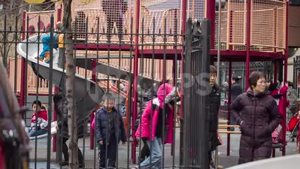 Asian-American kids playing in Chinatown playground - Chinese parents with their children