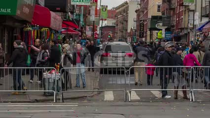 Little Italy sign - welcome - Chinese new year parade in Chinatown - crowded with people behind police barrier