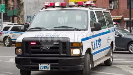 police van with turret lights flashing - NYPD vehicle