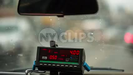 taxi cab coming to stop behind Honda - 4 dollars on meter