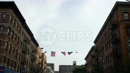 Puerto Rican and American flag in the Bronx - flags overhead in the neighborhood