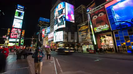 Elmo and ads in Times Square at night with bright lights and billboards - 4K timelapse at night in New York City