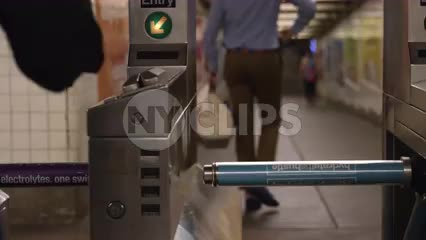 hand swiping Metro Card at turnstile in subway station in slow motion