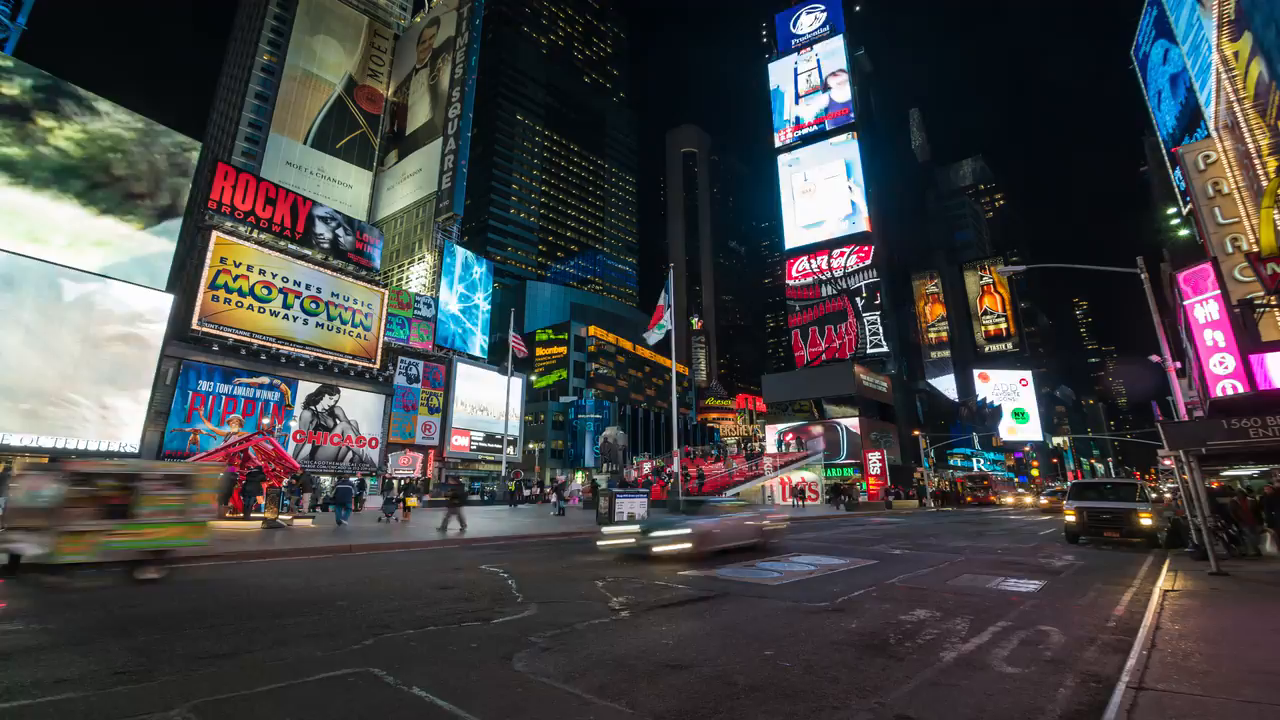 cars speeding by in Times Square at night with billboards and ads - traffic  timelapse in 4K Manhattan New York City