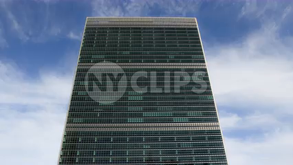 front upward angle of United Nations Building in Manhattan - 4K timelapse with blue sky and clouds