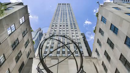 timelapse of Atlas statue outside Rockefeller Center tilting down from skyscraper to sculpture in 1080 HD in NYC