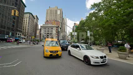 caravan taxi cab driving near Madison Square Park on 5th Ave