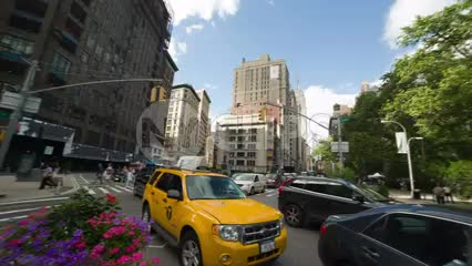 360 degree panoramic view - panning in Madison Square Park with Flatiron Building and skyscrapers on summer day with taxicab