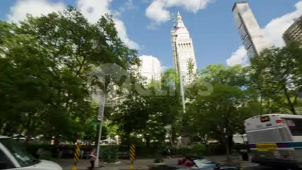360 degree view of Madison Square Park on 5th Ave with Flatiron Building and skyscrapers in summer