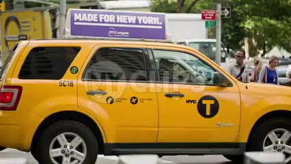 caravan taxi cab stopped at traffic light on Manhattan summer day