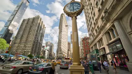 5th Ave and 23rd Street on summer day - famous clock and Flatiron Building